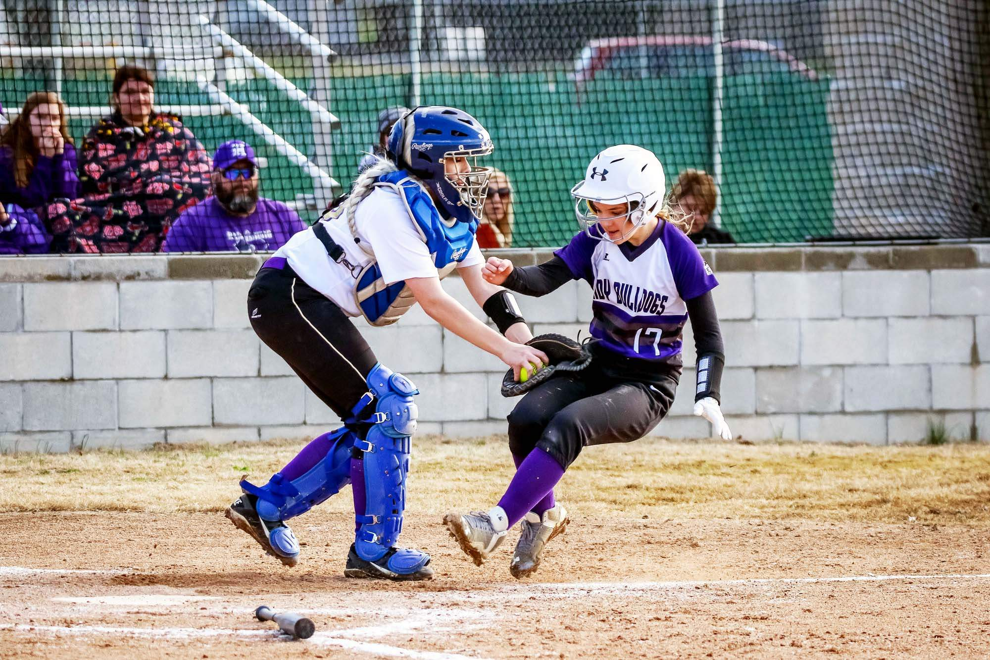 Eldorado catcher Madison Newton tags out Harrisburg runner ViVian Fuerback at home Friday in prep softball action.