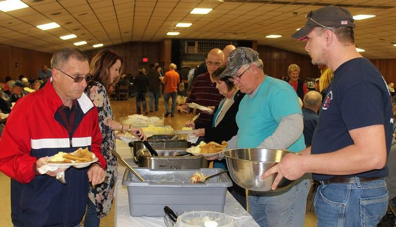 Here, meals are doled out at this year's successful Good Friday fish fry hosted by the Pinckneyville Volunteer Fireman's Association.