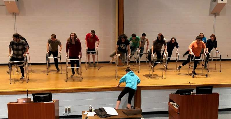 SIC alumnus and choreographer from New Hampshire Taryn Herman works with the cast for a scene in 'The Producers' at SIC.