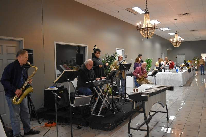 """Jazz band """"The Penguins,"""" under the direction of Jim Smith on the keys, plays during the Taste of Southern Illinois Sunday in Harrisburg. The band features, from left, George Sisk, Smith, Melinda Tolley, Bruce Boone, and Greg Hodson."""