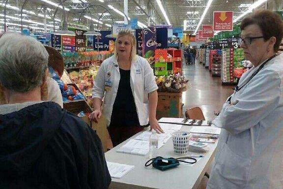 Egyptian Health Department health professionals prepare to test a person at the Harrisburg Walmart.