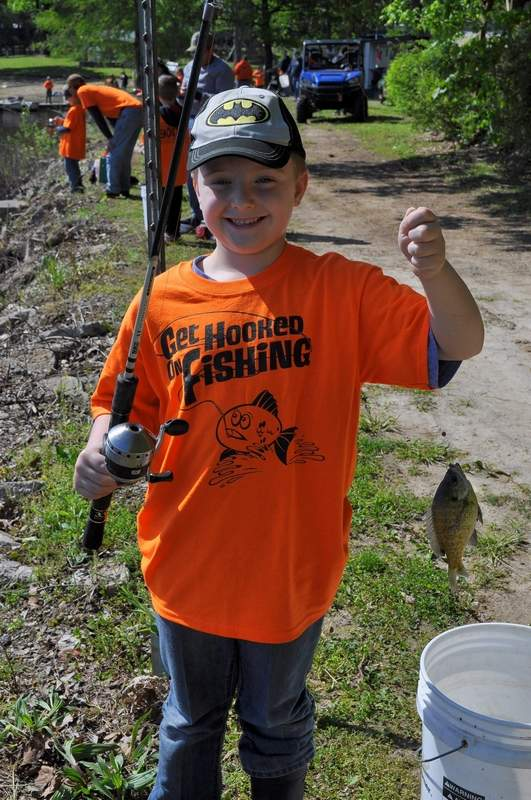 Liam Gibbs of Mulkeytown gets a fish for his bucket at last year's derby.