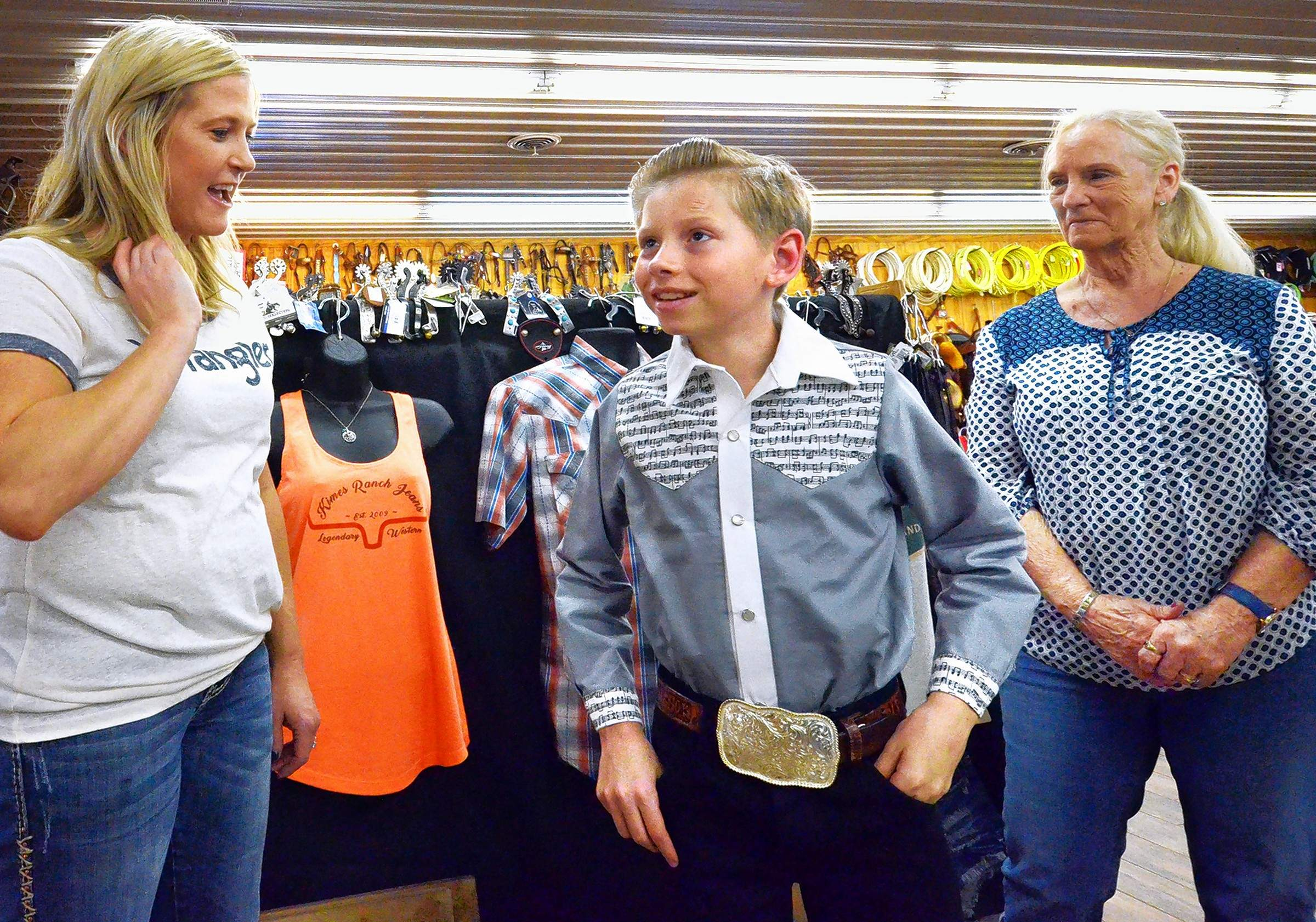 McKinney's Western Wear store employee Diane Williford, left, greets Mason Ramsey and his grandmother, Frances, right, when they arrived at the Marion business Wednesday.