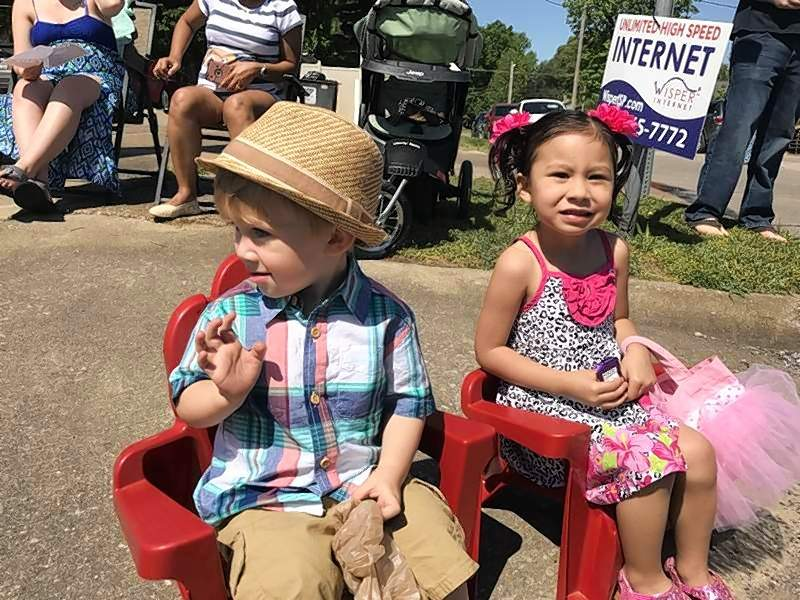 Cooper Hart, 2, and Ambrea Laird, 3, enjoyed last year's parade from their corner perch on North Main Street. This year's event is set for the same route and the traditional 10:02 a.m. start time.