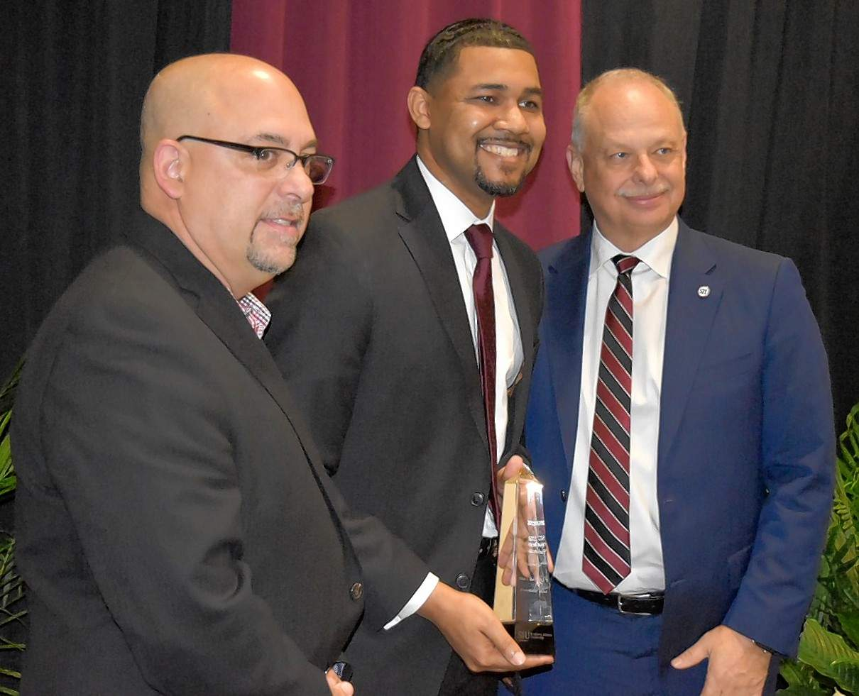 From left at Friday's ceremony are Larry Mieldezis, president of the SIU Alumni Association; CCHS principal Daniel Booth; and SIUC Chancellor Carlo Montemagno.