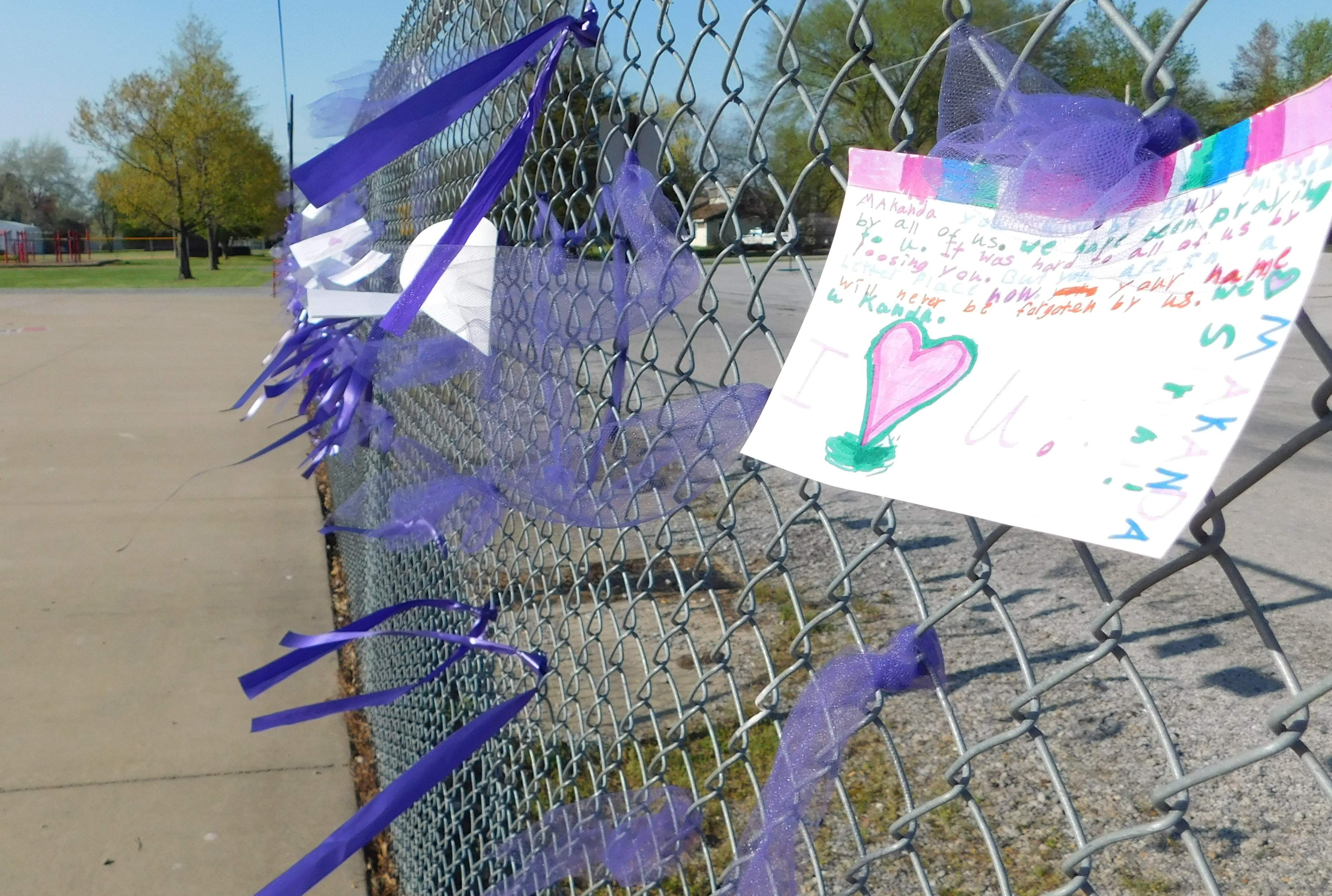 Messages tied with purple ribbons to the Ewing Grade School fence expressed sentiments of love and kindness to the family of Makanda Williams.