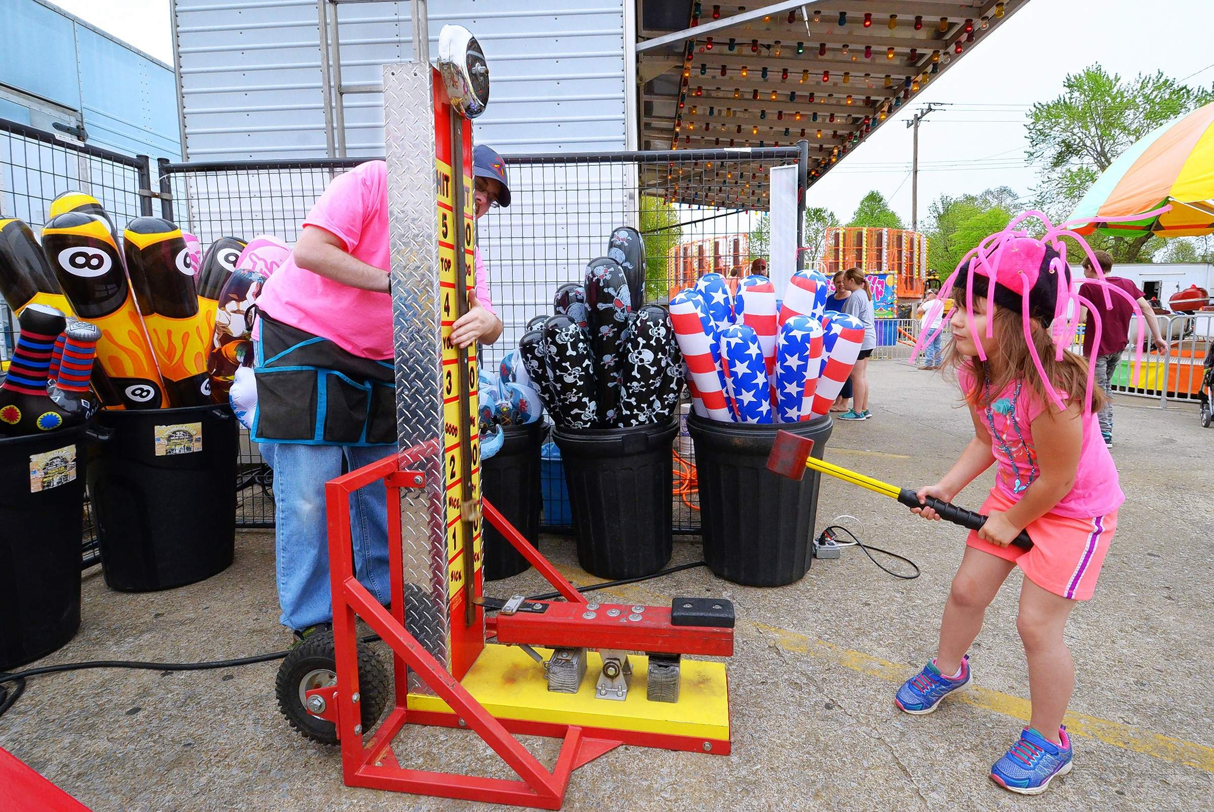 Ovanjolene Renee Finstad, 6, tried her hand at trying to ring the bell on this carnival attraction Friday night at the Rend Lake Water Festival in Benton. She waswith mom Keith and Amanda Finstad of Christopher.