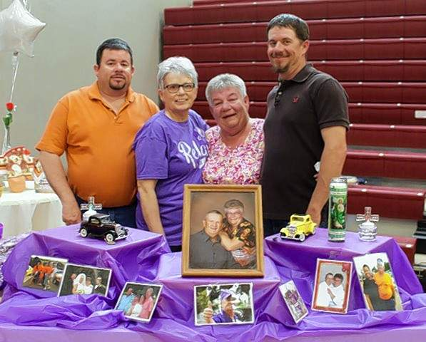 Tom Moll's family, from left, son, Wayne, sister Carla, wife Jeri and son Steve, stand by his memorial table. Moll was involved in the Relay For Life program for many years and was known as Mr. Relay.