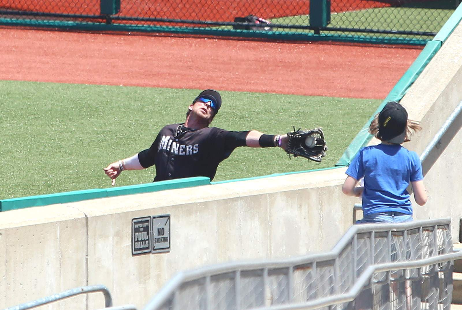 Bryson Bowman makes a catch near the wall during Tuesday's exhibition game against Evansville.
