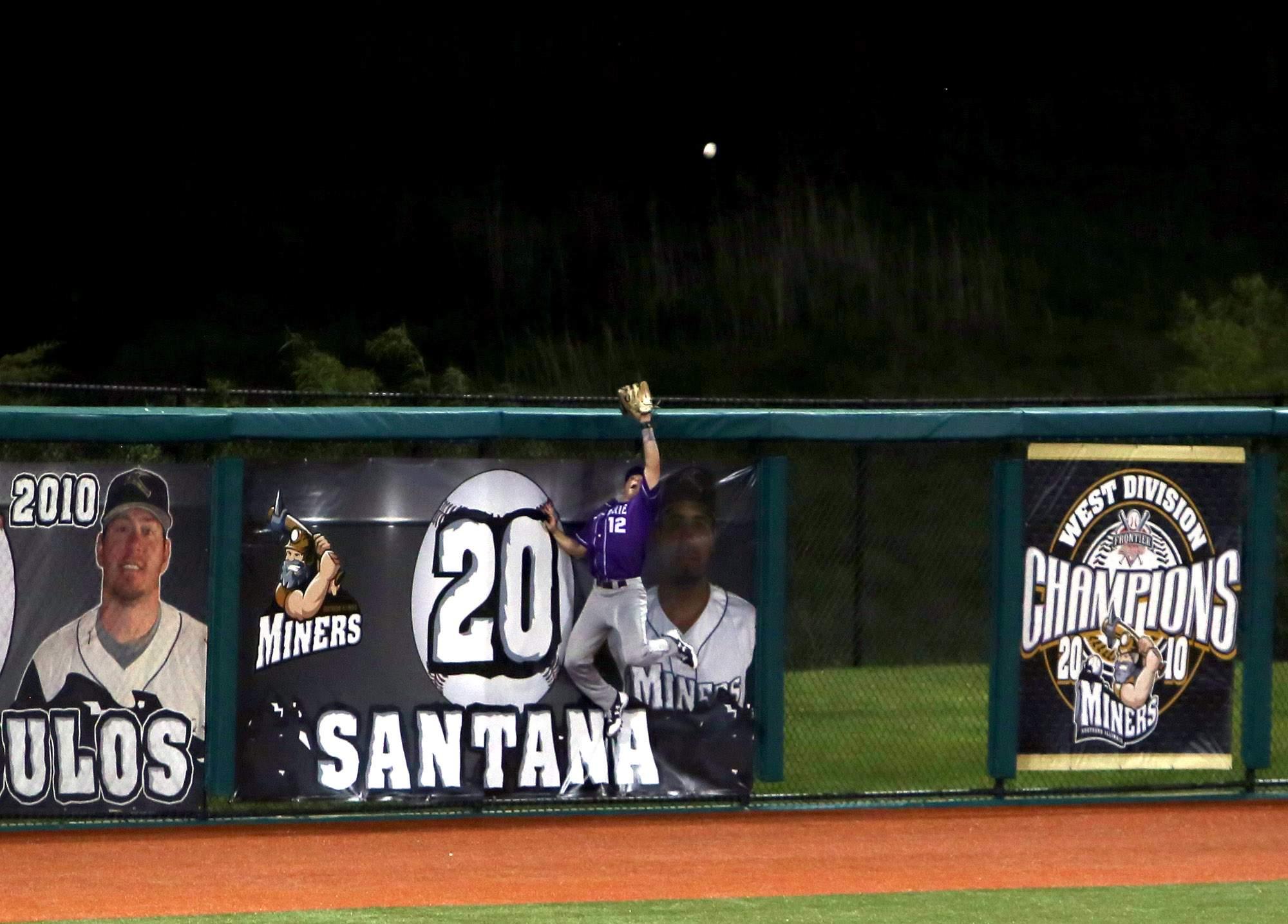 Cameron Newell robs Joe Dudek of a home run.