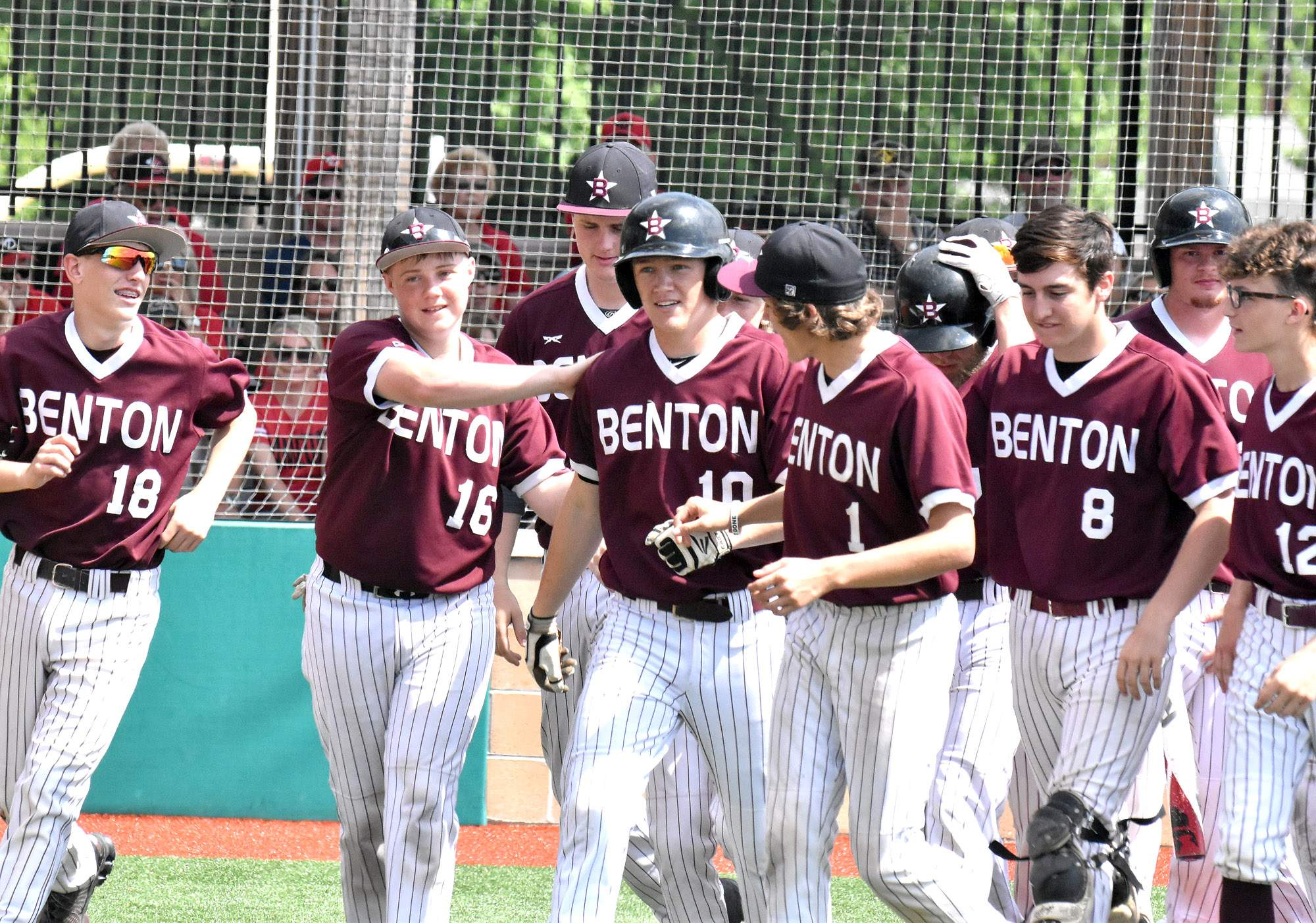 Hamilton Page (10) is greeted by his teammates after hitting a solo home run to lead off the fourth inning in Benton's 7-1 victory at Du Quoin on Saturday. Page's homer tied the game in the fourth and the Rangers tacked on a single run in the fifth and four more in the seventh.