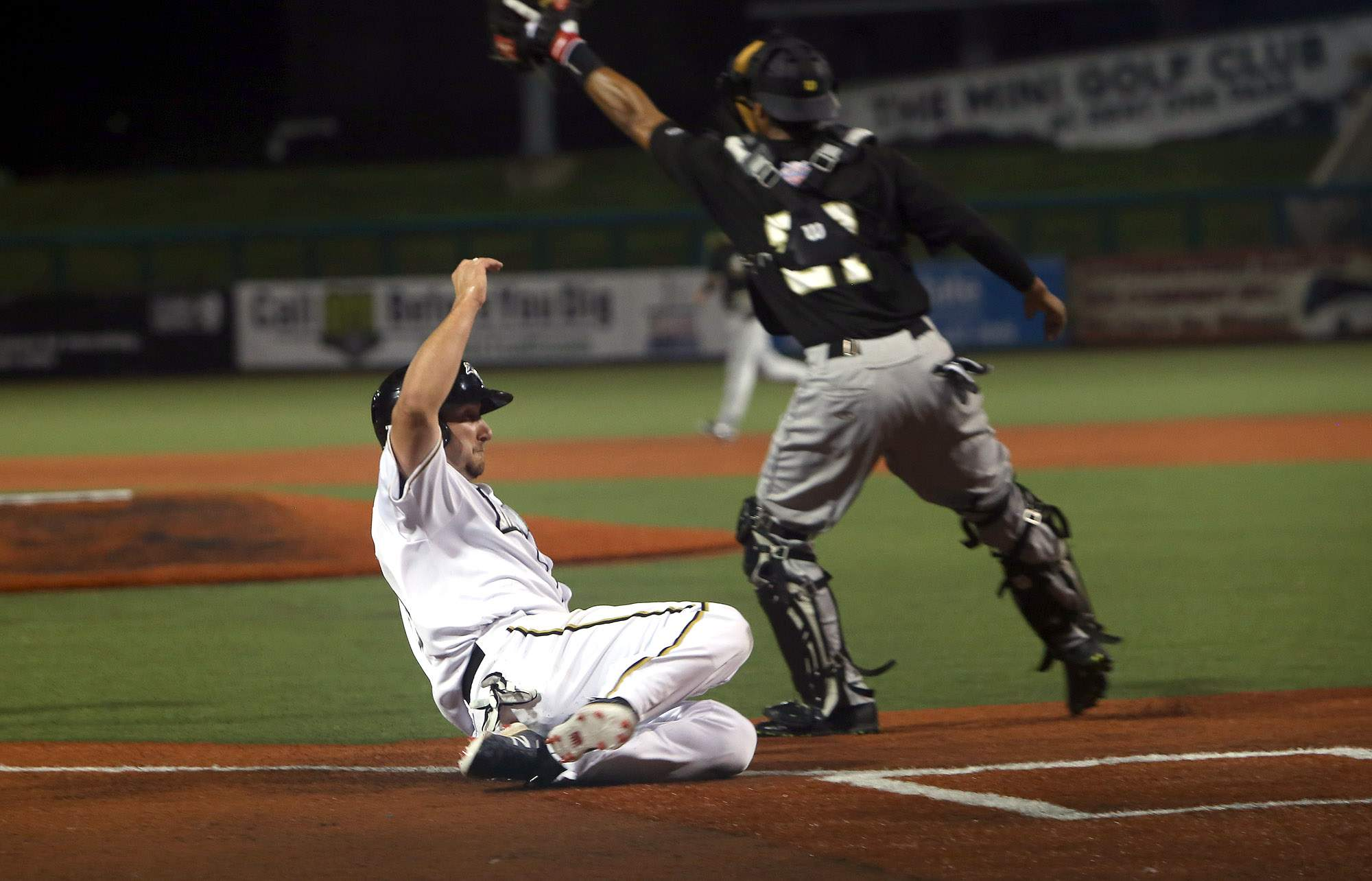 Joe Dudek slides home during the second game of Saturday's doubleheader against River City at Rent One Park.
