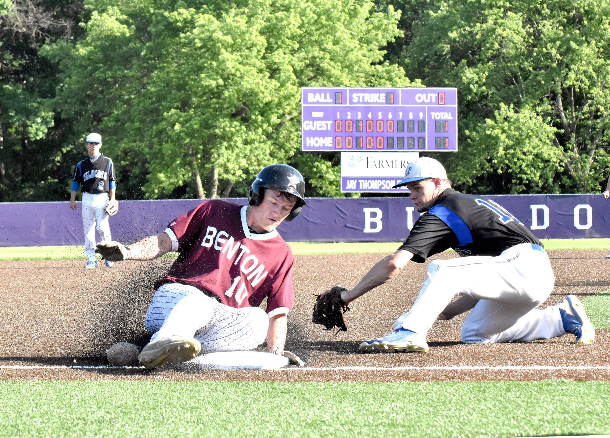 Benton High School senior Hamilton Page slides safely into third base during the sixth inning. Page would eventually score the go-ahead run as the Rangers beat A-J 3-1 at Harrisburg on Wednesday.