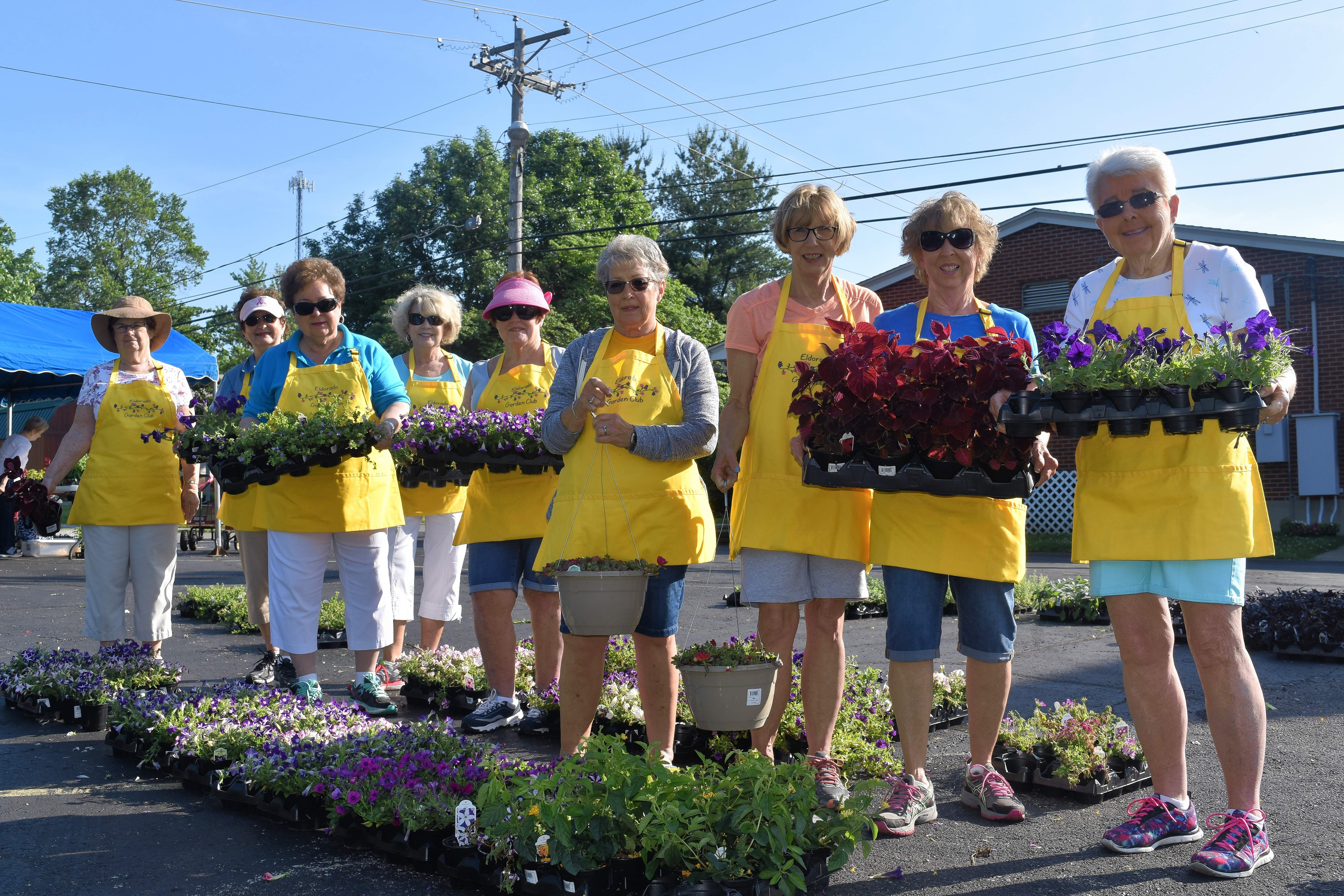 "Members of the Eldorado Garden Study Club hold a variety of flowers for sale at their annual ""Truckload Plant Sale"" Wednesday."