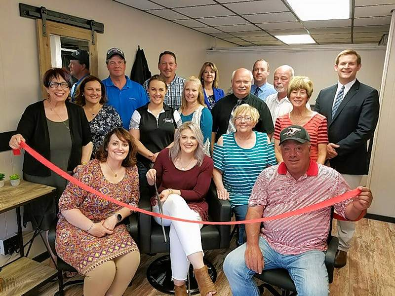Salon Serenity Seated, Deb Franklin, mother of the owner; Kraiten Franklin, owner/stylist; Phyllis Ferguson, Kraiten's grandmother; and Mayor Tom Page. Standing, Chamber and community members, Gwendy Garner, Marge Sanders, Ron Woodworth, Chelsea Schroeder, Dan Colvis, Diane Hecht, Mary Sulser, Don Otten, Bruce Luthy, Jr., John Lane, Linda Sympson and Kris Koeneman.