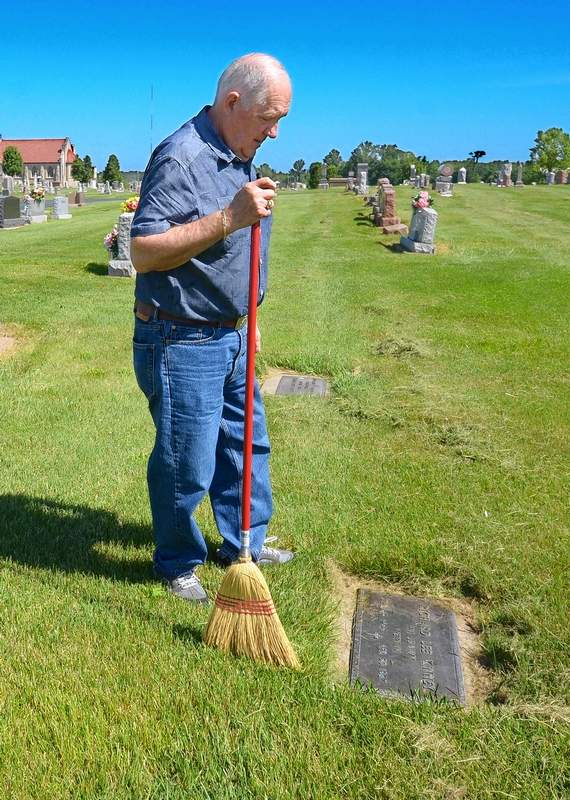 After carefully sweeping freshly mowed grass away from his late brother Richard Lee Kinney's brass foot marker at Marion's Rose Hill Cemetery, Jerry Kinney pauses to think about the young war hero who was killed in action at age 19 in Vietnam. Kinney said, 'Being brothers, we talked quite a bit about our plans in life, and he told me that when he got home from Vietnam, he was going to go to SIU in Carbondale and study dentistry. But a bullet from a Vietcong machine gun ended that dream and his life, as well.'