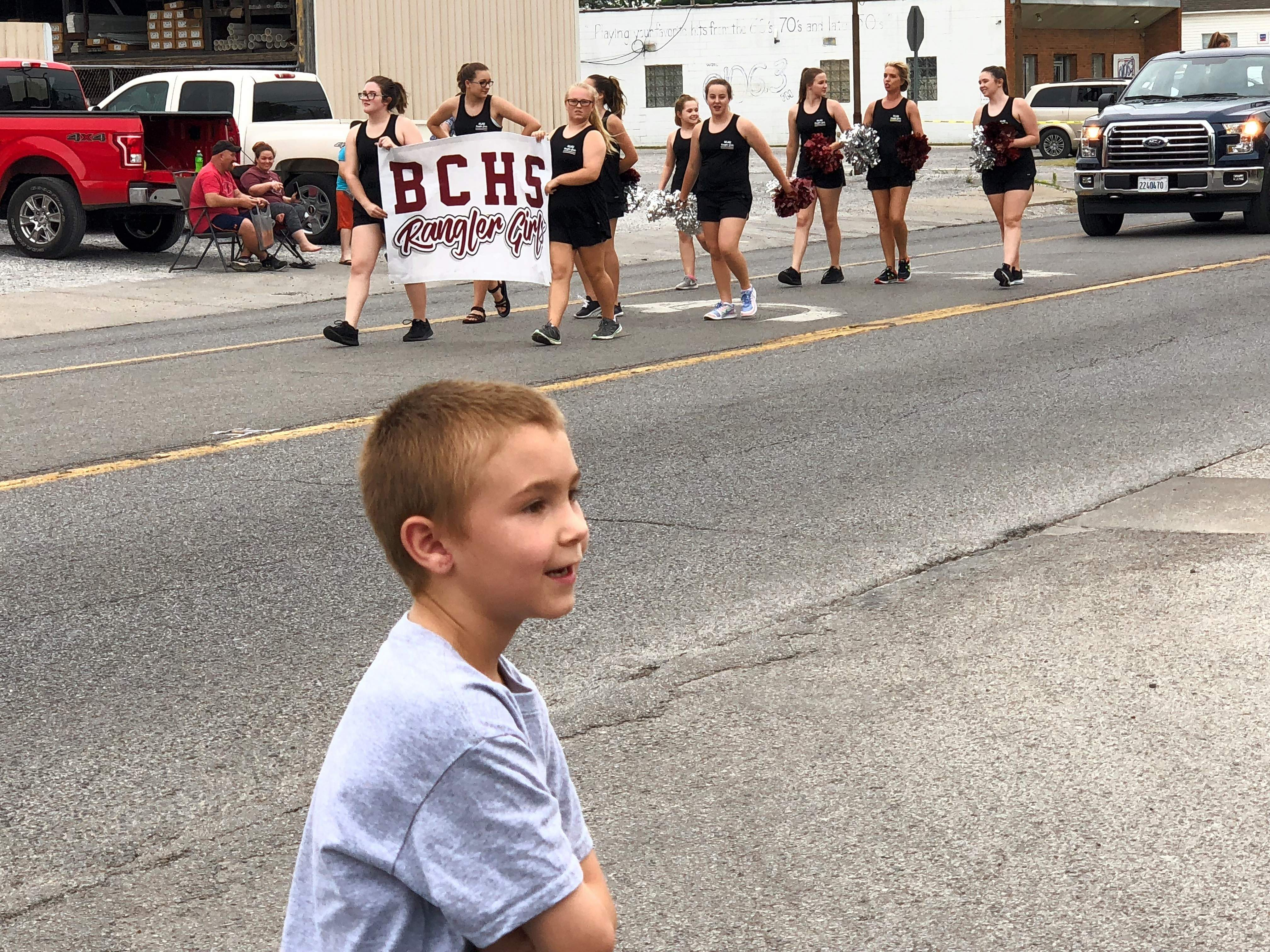 Chase Faltner watches as the BCHS Ranger Girls pass by during the Farm City Days parade Saturday in Benton. The 7-year-old from Christopher said his favorite parts of the parade are the 'candy and bid tractors.'