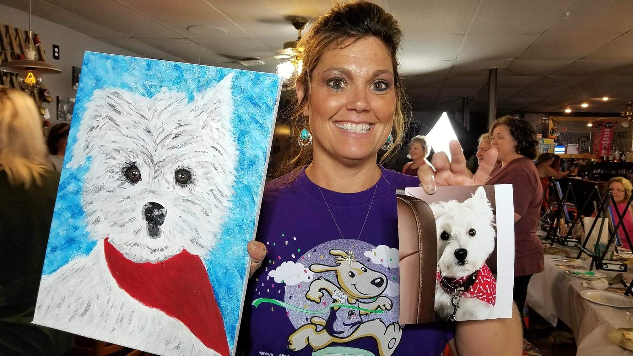 Sheila Snyder of Carbondale poses with her finished picture of her dog, Drake.