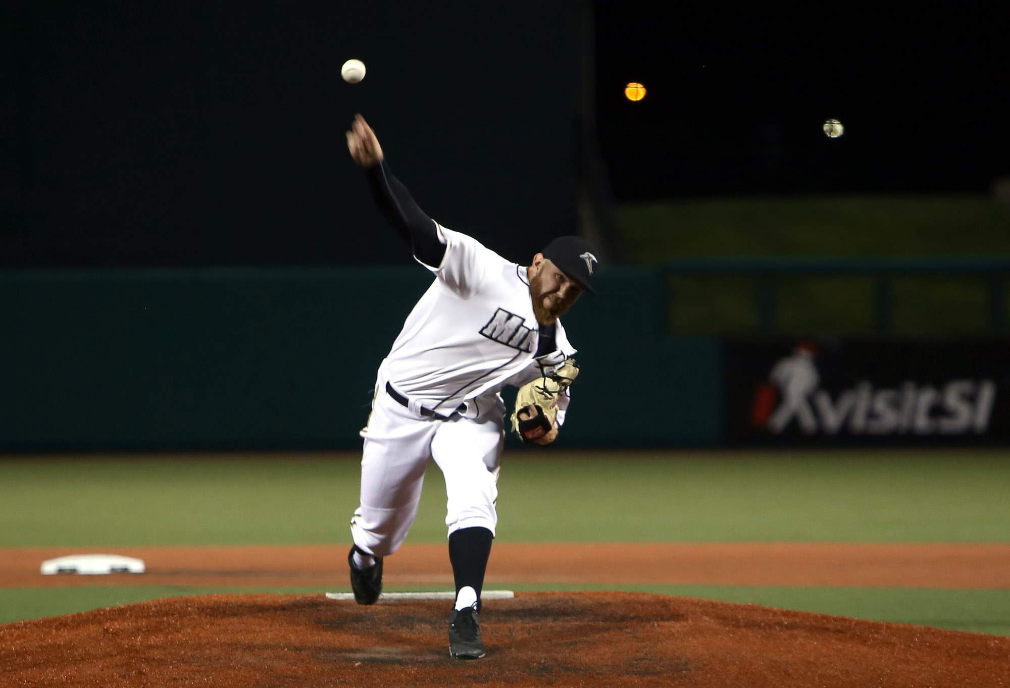 Robby Rowland throws a pitch on opening night.