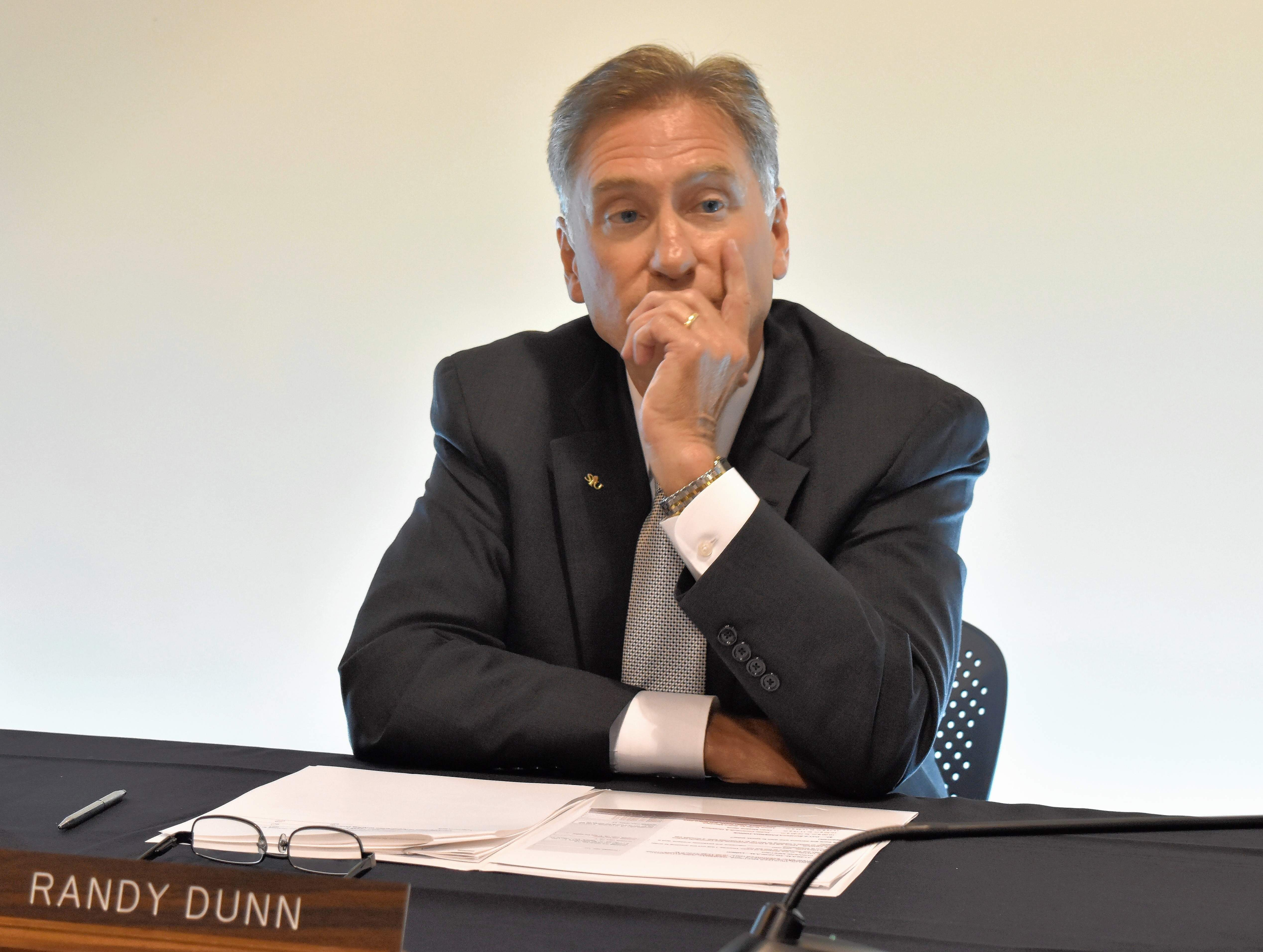 SIU System President Randy Dunn awaits word of his fate on Thursday in Edwardsville.