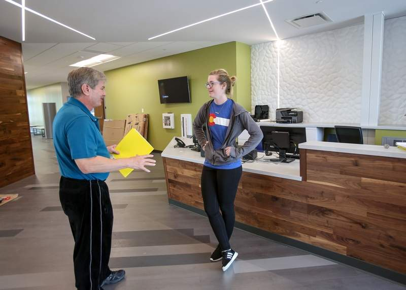 Katy McKinnon, right, facility manager for Lombard Park District's new Madison Meadow Athletic Center, meets with Thomas Perek in preparation for the facility's grand opening this weekend.