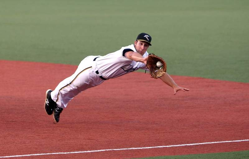 Miners first baseman Joe Dudek makes a diving stop on the first pitch of Wednesday's second game against Florence.