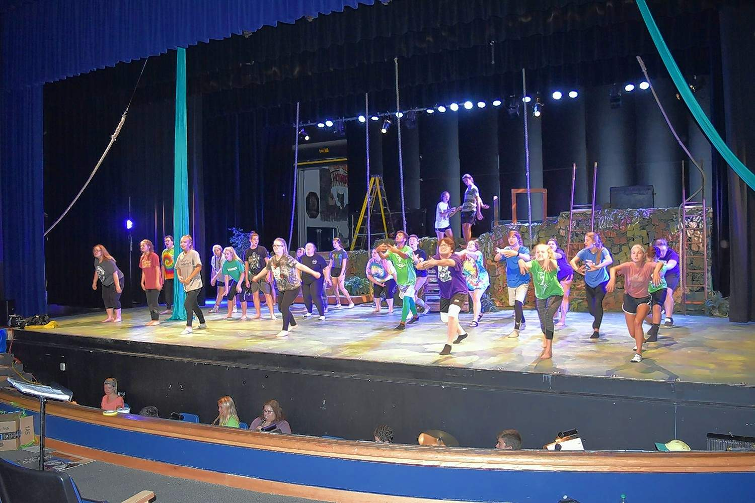 Cast members of 'Tarzan' perform the finale during a technical rehearsal Tuesday night.