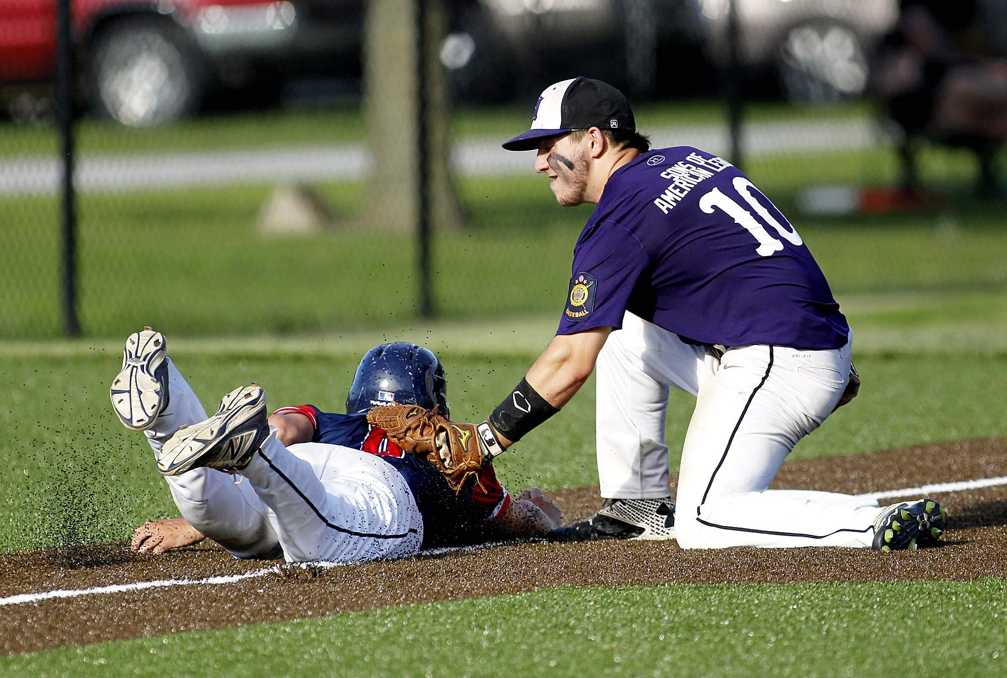 Harrisburg American Legion Post 167 third baseman Bayden Ditterline applies this tag to put out Marion Post 147 pinch runner Jake Griffin in action Friday night at Jay Thompson Field in Harrisburg.
