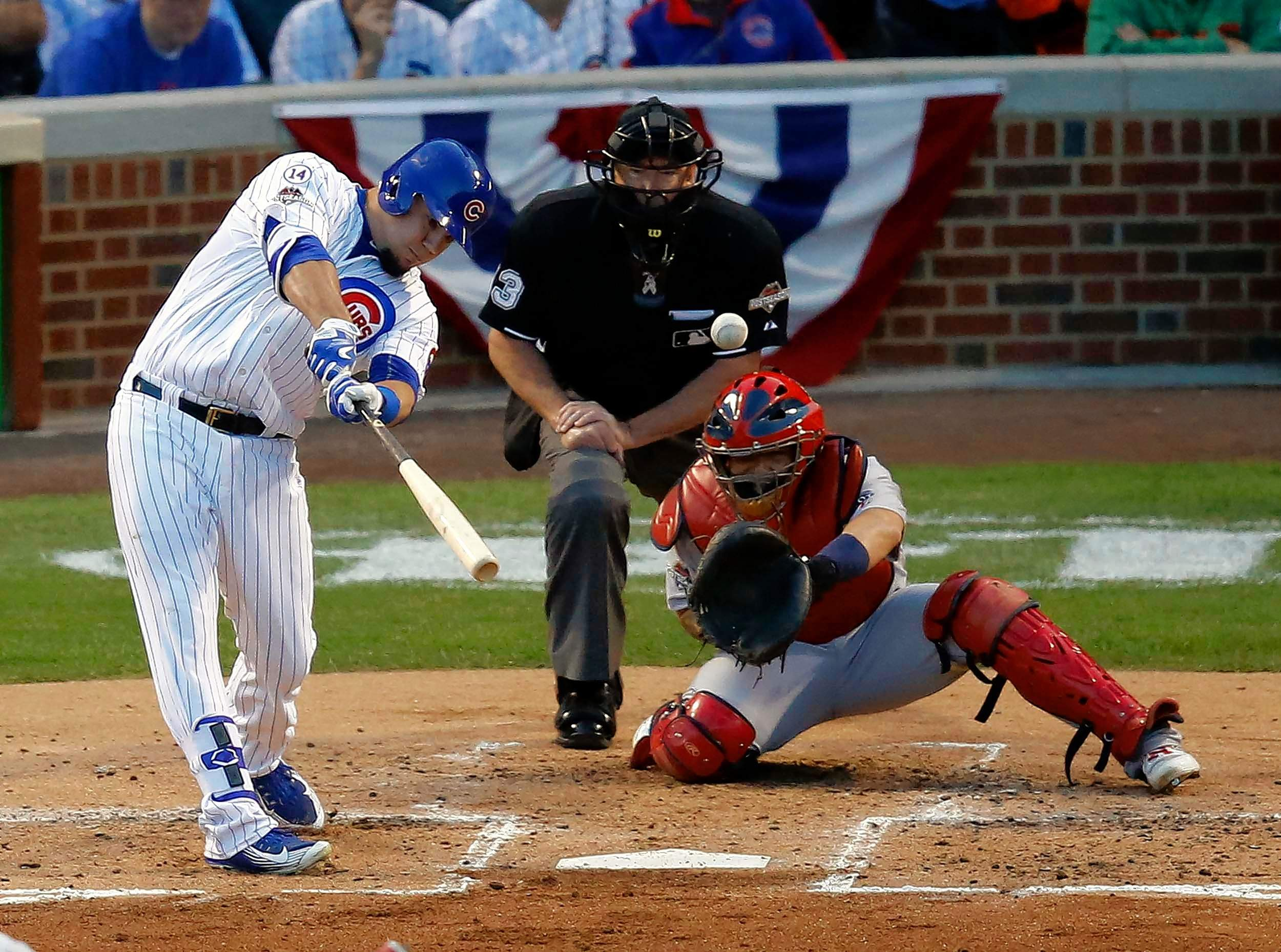 Kyle Schwarber (12) hits a home run against the St. Louis Cardinals during the second inning of Game 3 in the 2015 National League Division Series.