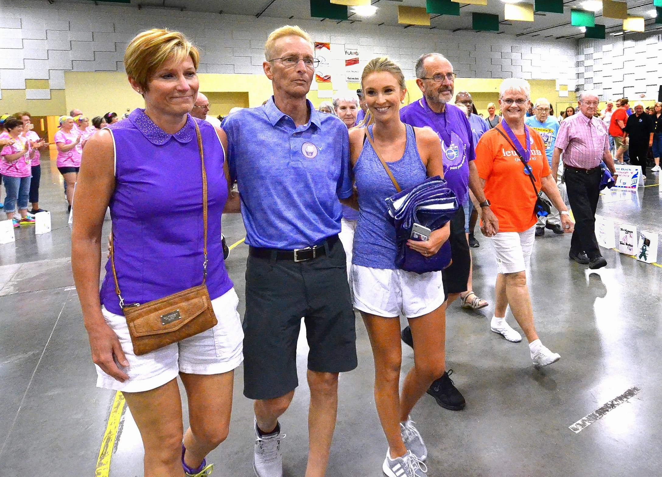 Traditionally, the second lap at American Cancer Society is made up of survivors and their caregivers. Among them participating in that lap in Marion Saturday evening was Marion resident Chuck Robertson, seen here arm-in-arm with his wife, Sarah, and daughter, Ashlyn.