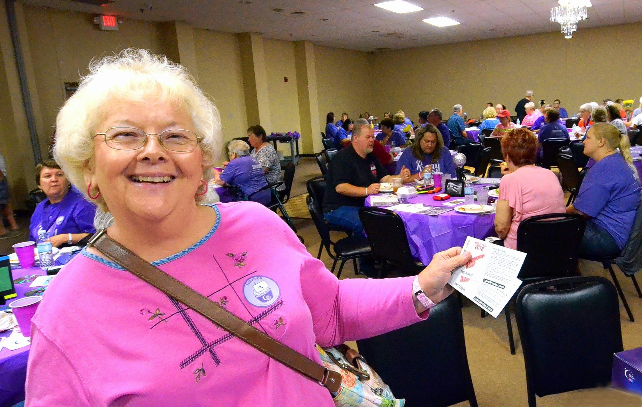 Mary Beth Livesay of Marion was among the cancer survivors who enjoyed the Survivors Reception at The Pavilion of the City of Marion Saturday just before the Relay For Life festivities to raise money for the American Cancer Society. Here, she shows off the pair of tickets she won to a St. Louis Cardinals baseball game at Busch Stadium.