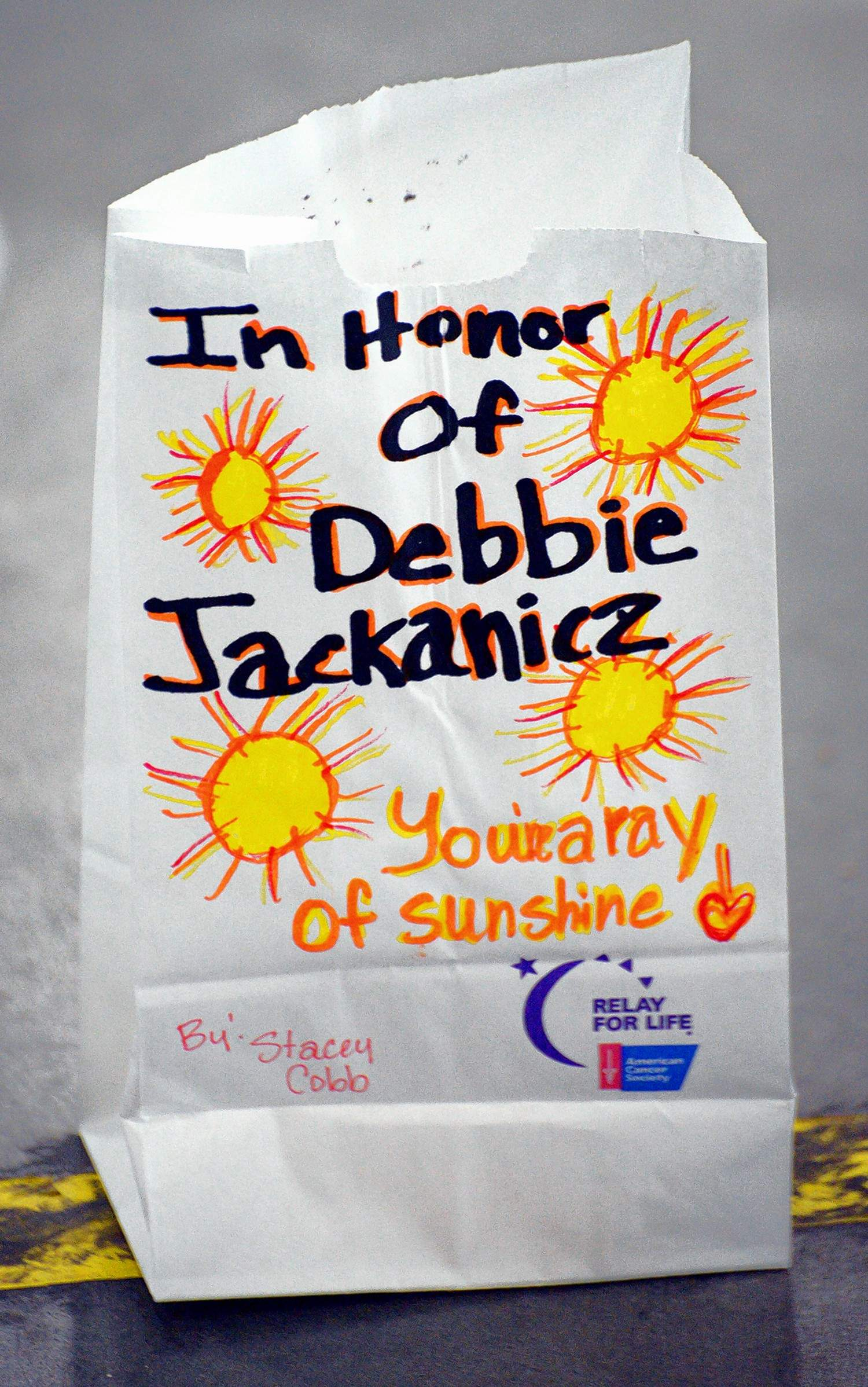 One of the hundreds of luminary paper bags that would be lit as part of the closing ceremony Saturday night at the Relay For Life at The Pavilion of the City of Marion.