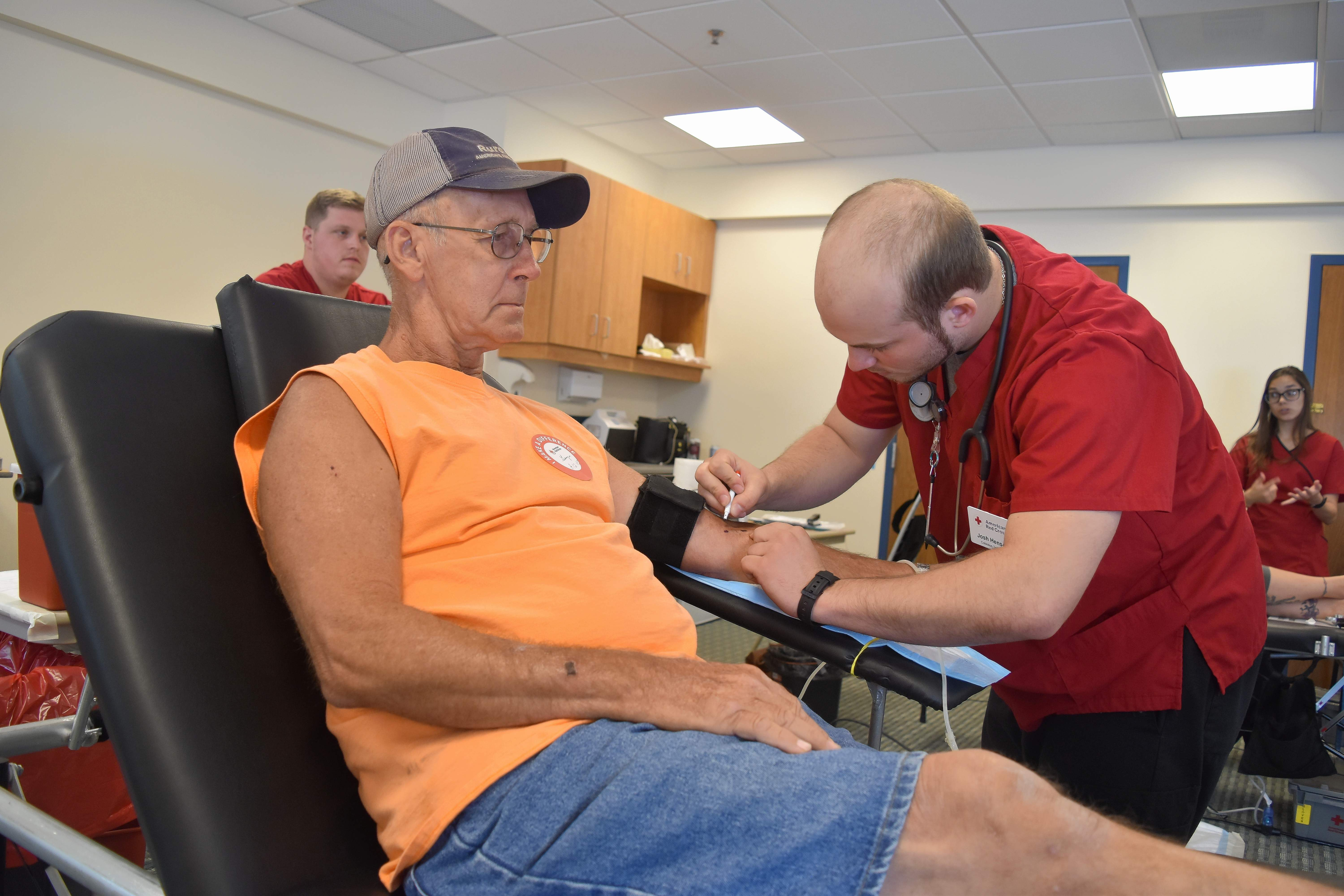 Gary Korbar of Du Quoin took time out of his day to donate a pint of blood at Thursday's drive hosted by Marshall Browning Hospital. Korbar says he donates every three months, and has done so for the last three years. Preparing to draw his blood is Josh Henson, a phlebotomist with the American Red Cross.
