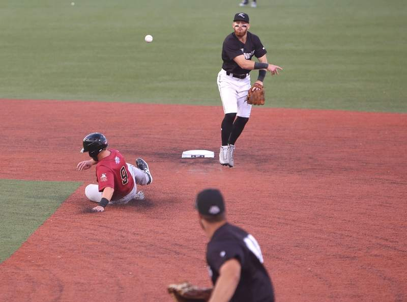Max Dutto throws to first base Wednesday night.