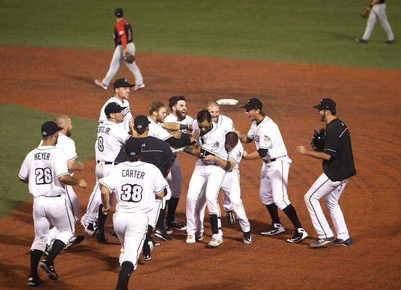 The Miners celebrate Friday's walkoff win over the Freedom after Harrison Bragg's RBI single in the 11th inning.