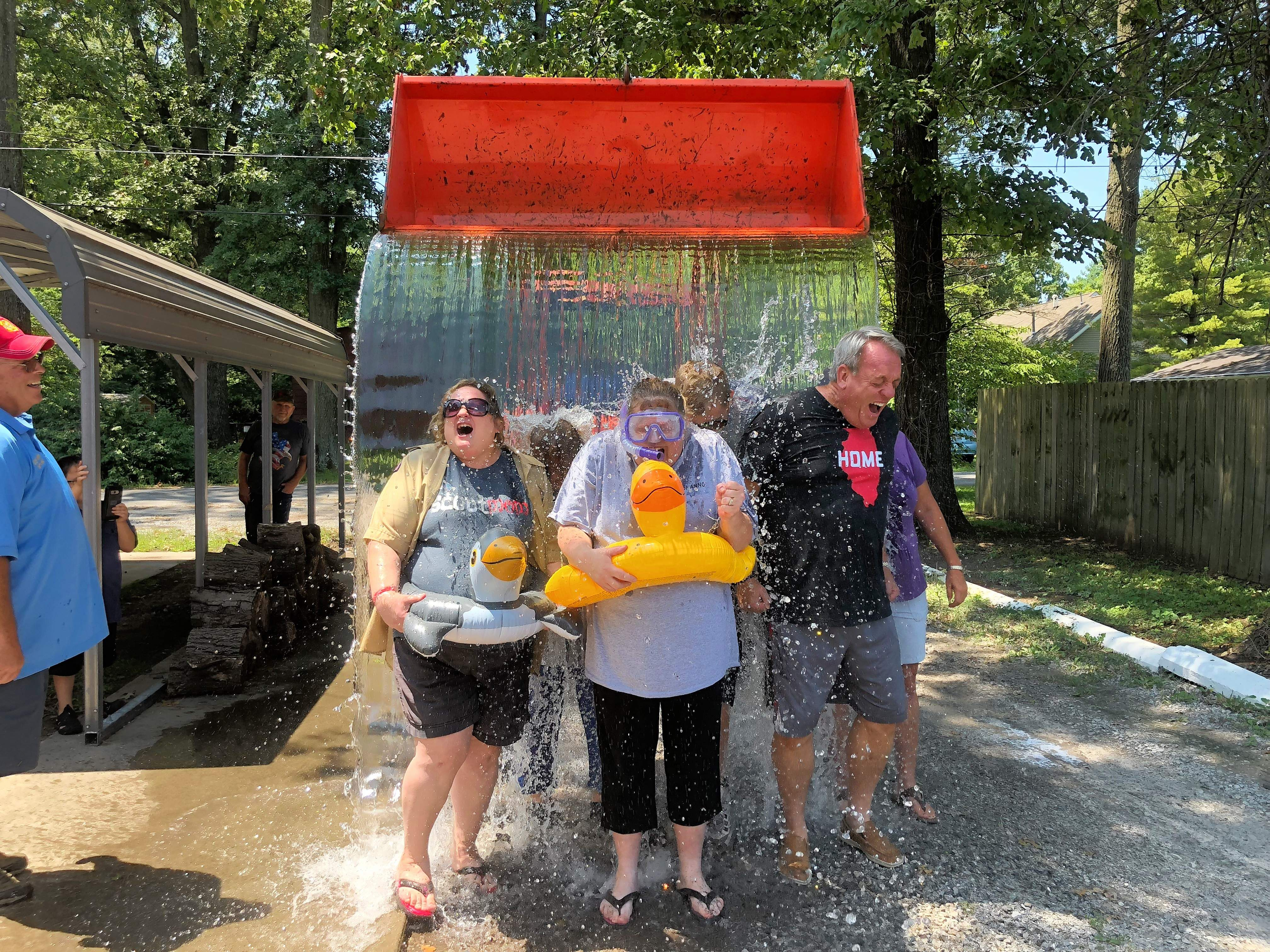 From left, Pamela Bennett, Shannon Carr and state Sen. Dale Fowler lead the first group in the ice bucket challenge in Benton on Saturday.