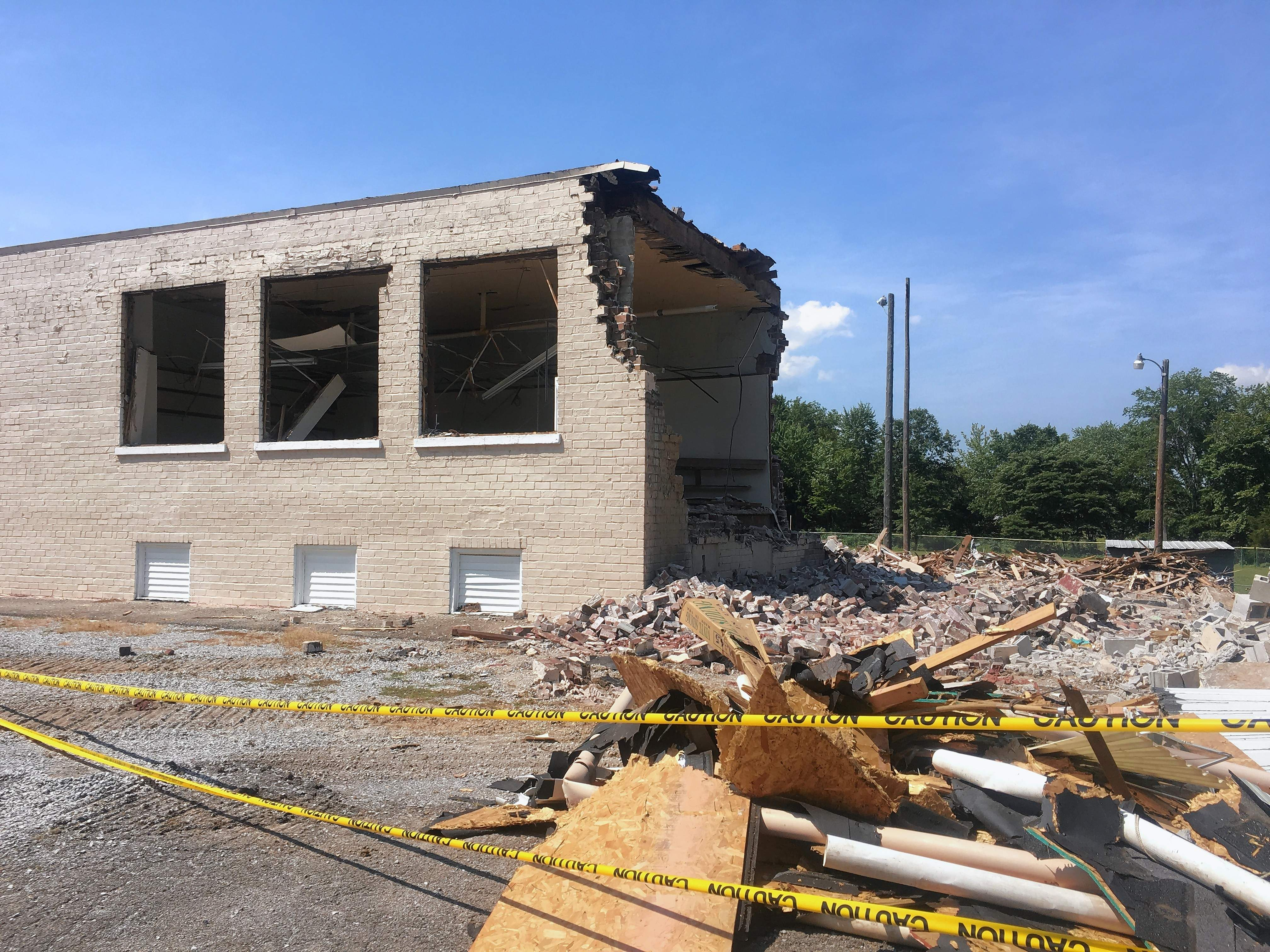 Work proceeded over the weekend in Logan, tearing down the east portion of the former grade school to make way for a new addition that will house a kitchen and restrooms for what is now the community center.