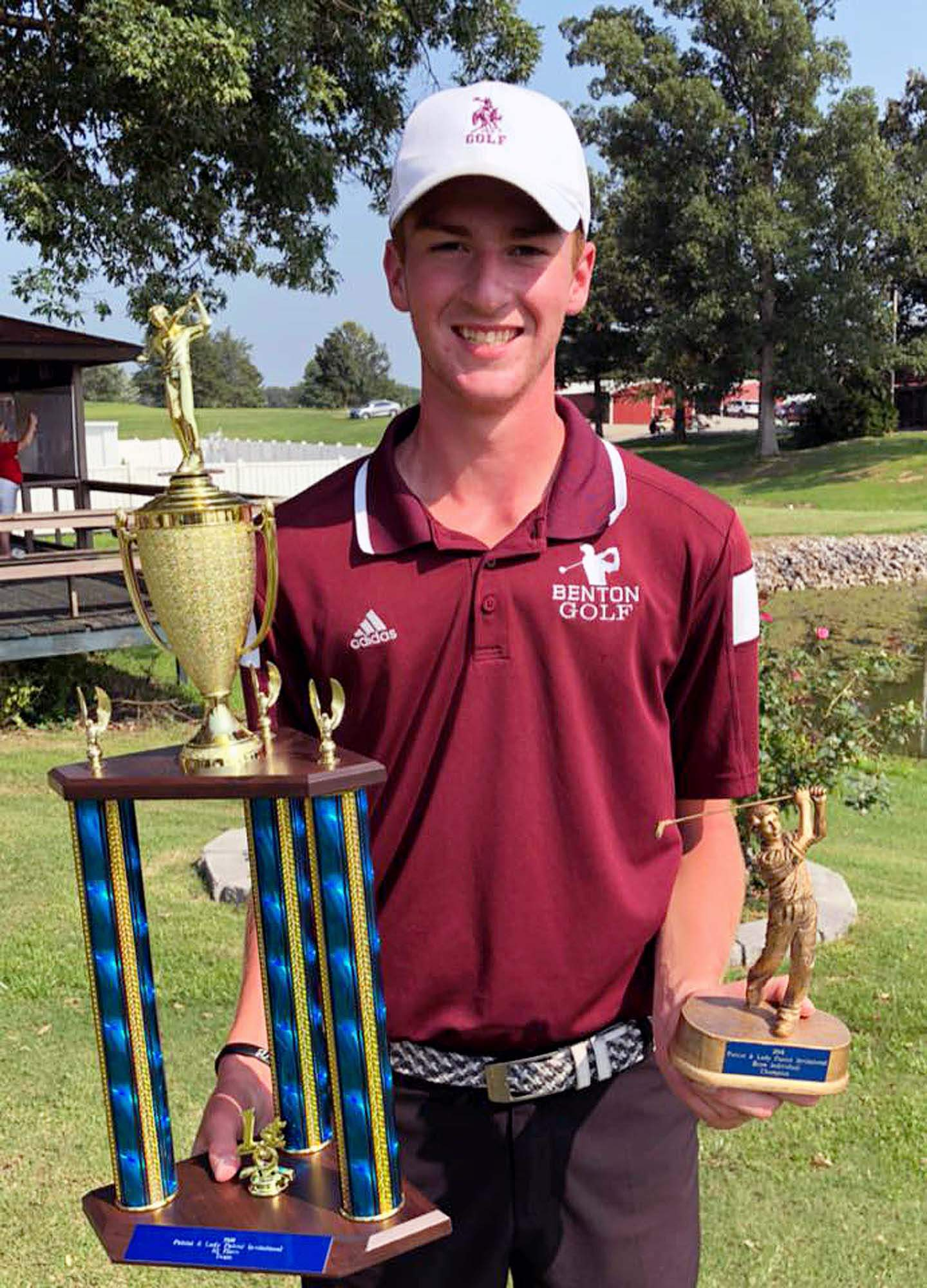Brendan Luster holds the trophy he won for being the match medalist at the Massac County Invitational this past Saturday. It was the 10th time in Luster's career that he won medalist honors.