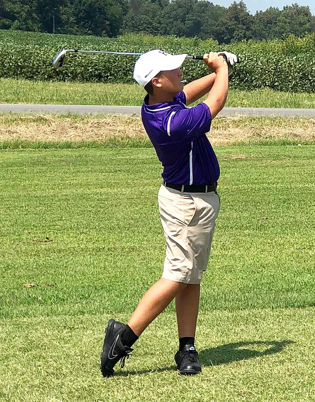 Ashton Hall watches this approach shot on No. 14 Saturday at Metropolis Country Club