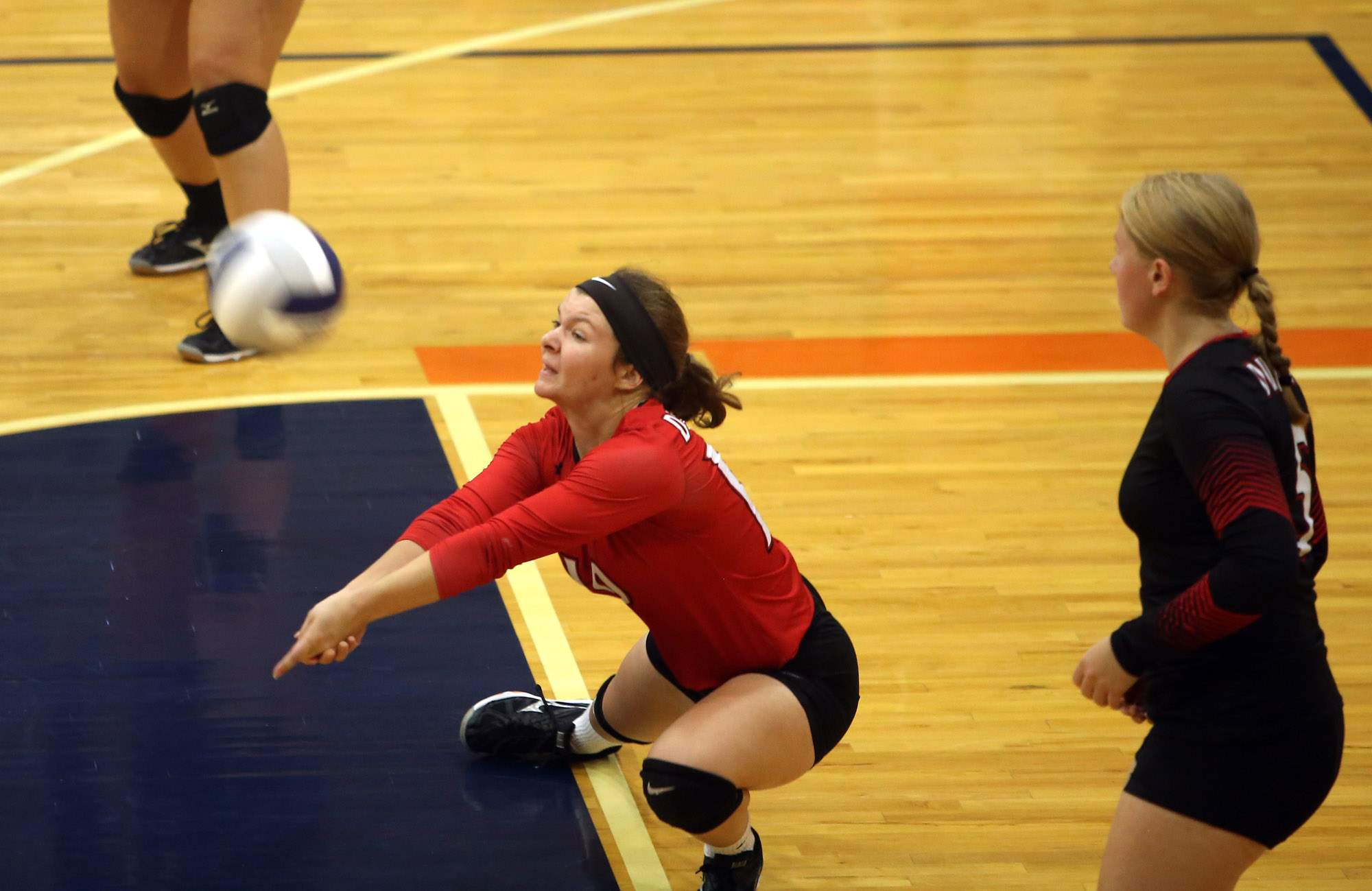 Du Quoin libero Katie Smith digs the ball during Saturday's tournament.