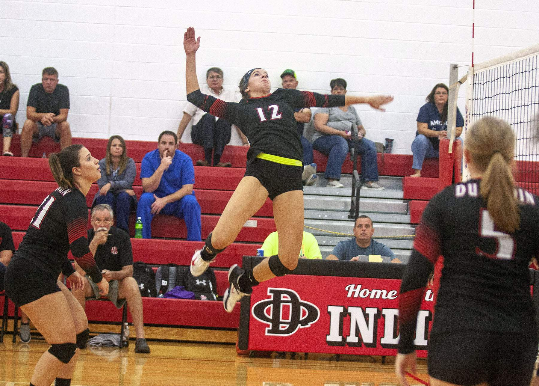 Elizabeth Bird leaps for a spike Tuesday night.