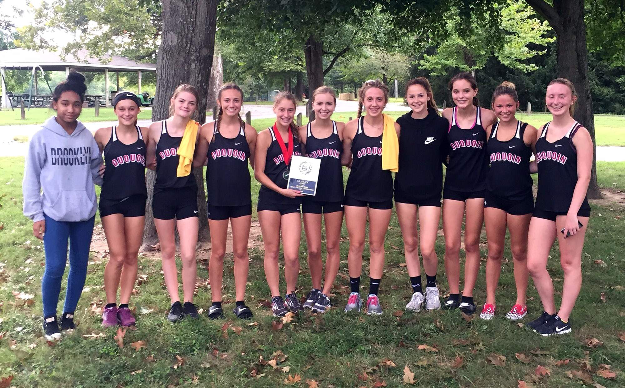 The Du Quoin High School girls cross country team poses with the Murphysboro Invitational championship plaque Wednesday.