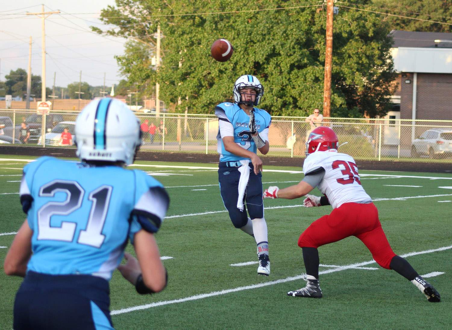 Hunter Riggins completes a pass on the first play from scrimmage Friday night.