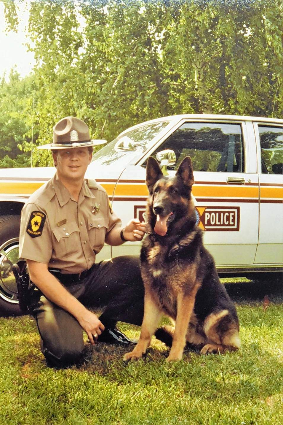 Keith Brown pauses for a photo with his K-9 partner Mac.