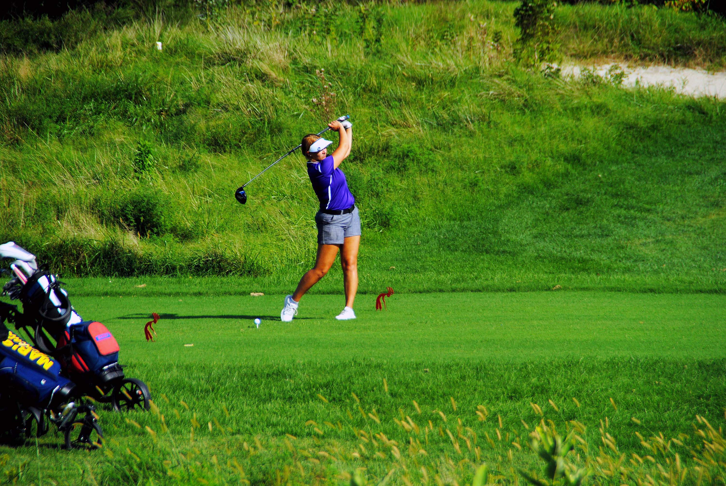 Harrisburg's Alli Ferrell warms up with a practice swing, prior to taking a shot at last week's Marion Invitational at Kokopelli Golf Course. Ferrell had the low round for Harrisburg, shooting a 95.