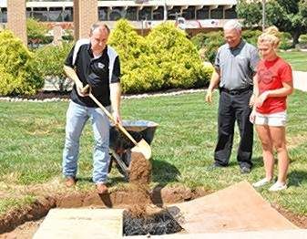 RLC President Terry Wilkerson uses one of the shovels that broke ground on the college's campus 50 years ago during Thursday's time capsule burial. RLC Board Member John Kabat and Student Trustee Mackenzie Trader were on hand to assist.