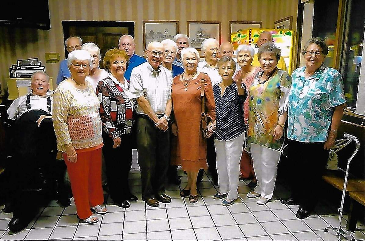 Chester High School Class of 1953 reunion attendees included, Front row from left, Betty Mennerich Wagner, Violet Diercks Luedeman, Nick Colbert, Fern Wright Winter, Gladys Zang Carter, Darlene Bollman Gillilan, and Alice Moeller Hollmann. Back row from left, Joe Schirmer, Don Wingerter, Louise Thomas Greenwood, Jack Lindsey, June Hohgrefe James, Dale Grott, Edna Dethrow Thomas, Don Welge, Ruth Schroeder Tiller, and Jim Bivens.