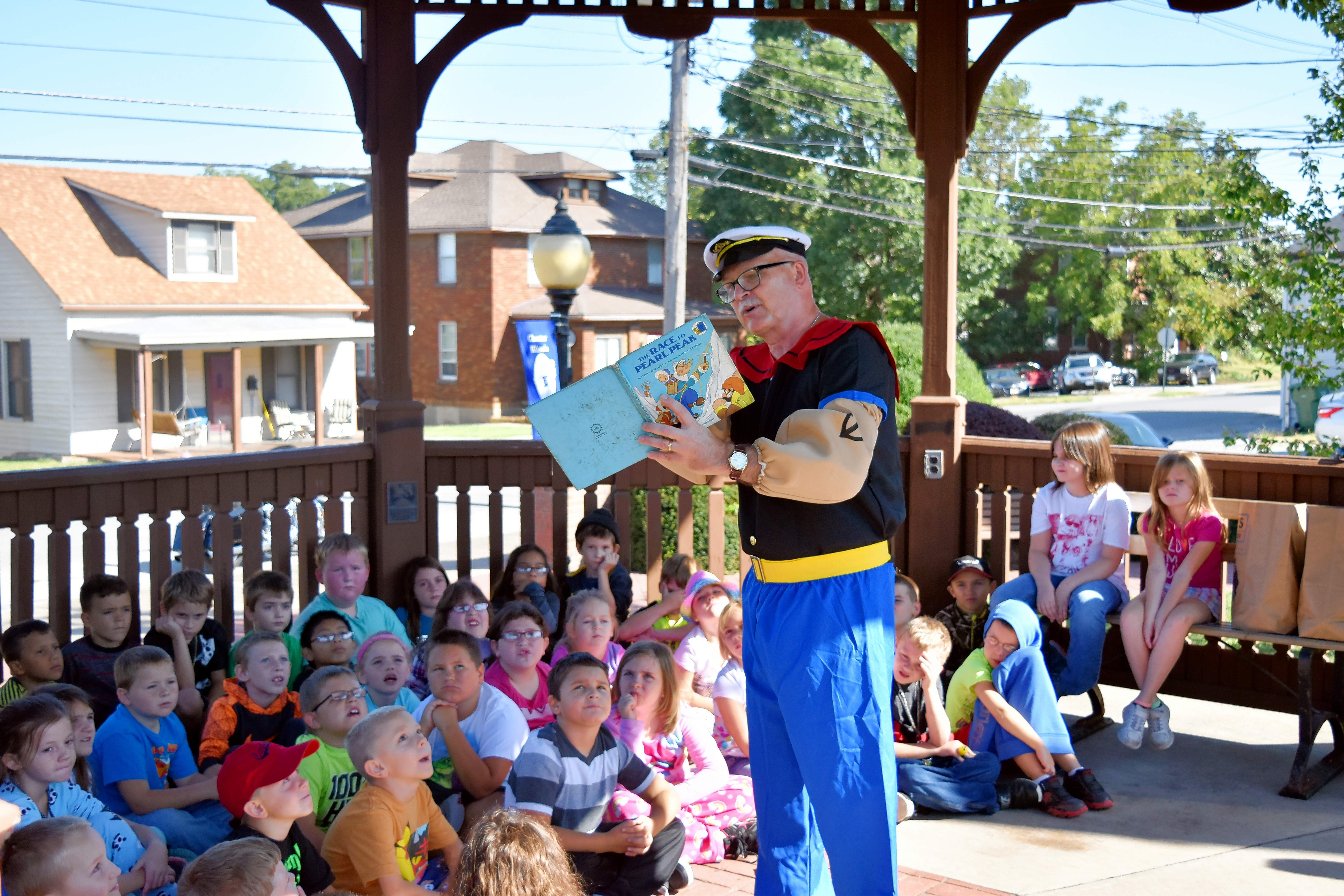 "Popeye, played by Mike Liefer, reads to Chester Grade School second grade as part of the buildup to the 2017 Popeye Picnic. This year's Popeye Picnic will honor the state's 200th birthday, with the theme ""Popeye Celebrates The Bicentennial, Where Illinois Began. """