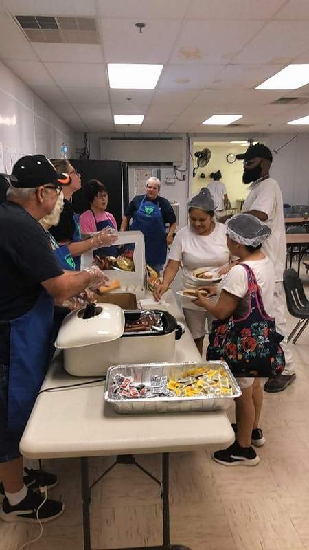 Members of Chester's Free Baptist Church serve meals to workers at the Chester Gilster-Mary Lee facility. Pastor Mike Fogerson said it was a way to celebrate Labor Day, by doing something nice for one of the largest work forces in the community.