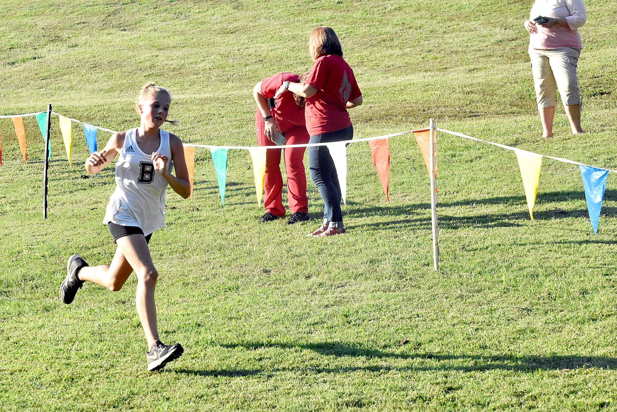 Benton High School's Hailey Wallace nears the finish line during the girls' race during the Mr. A Classic at the city park last week. Wallace finished third. Teammate Mia McLain won the girls' race with a winning time of 18:41.